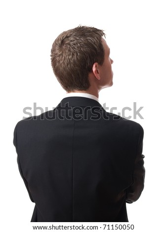 back of pensive young businessman looking up isolated on white background - stock photo