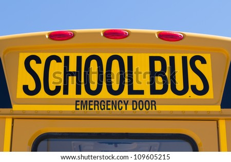 Back of school bus with a sign - stock photo
