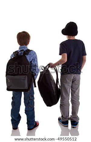 Back of schoolboy holding backpack - stock photo