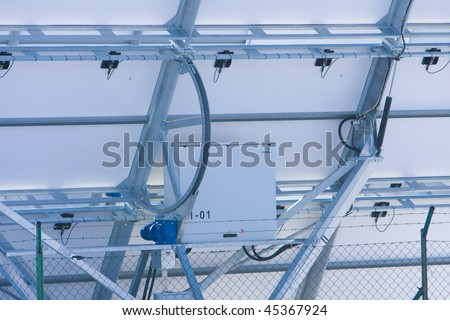 Back of Series of Photovoltaic Solar Panels for Electricity Production - stock photo