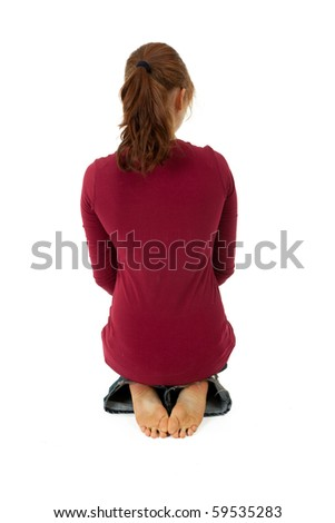back of sitting on alloys woman, isolated - stock photo