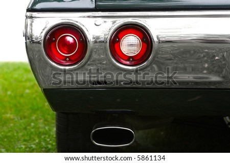 Back of the old car. Air pollution concept - stock photo