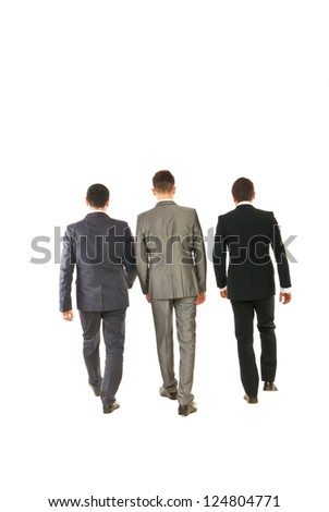 Back of three business men walking isolated on white background