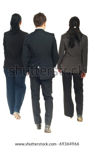 Back of three business people walking isolated on white background