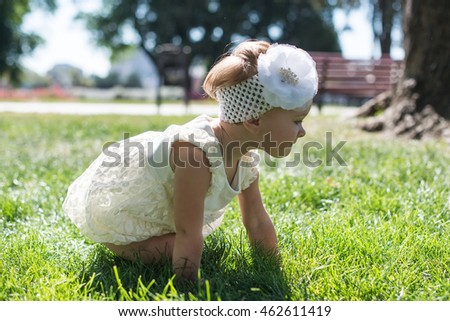 Back of Toddler little girl on Grass