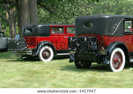 Back of two antique cars - stock photo