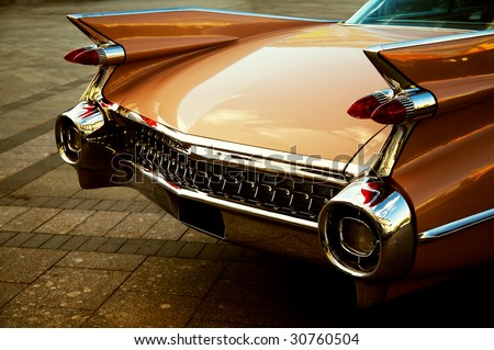 Back of vintage car in sepia tone - stock photo