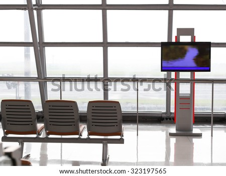 Back of wating chair at airport and television for time table screen in terminal - stock photo