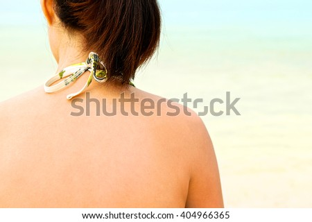 Back of woman skin for sunscreen lotion, Sun protection. Beach and sea. Back view. Close up. - stock photo