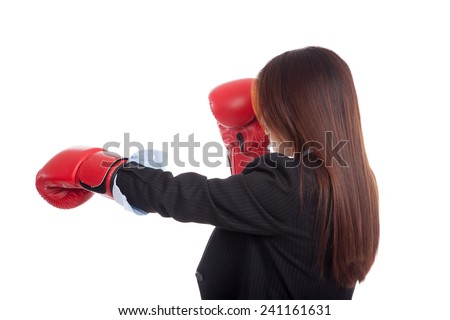 Back of young Asian businesswoman with boxing glove  isolated on white background