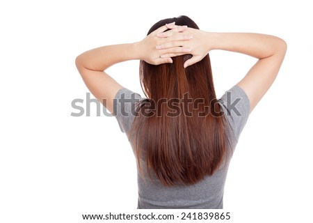 Back of young Asian woman put hands on head  isolated on white background