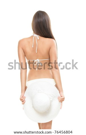 Back of young beautiful woman brunette isolated on white background wearing summer beach hat and bikini. - stock photo
