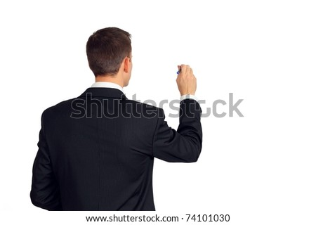 Back of young man in a suit writing or drawing something - stock photo