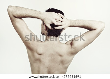 Back of young naked man with beautiful body isolated on white background - stock photo