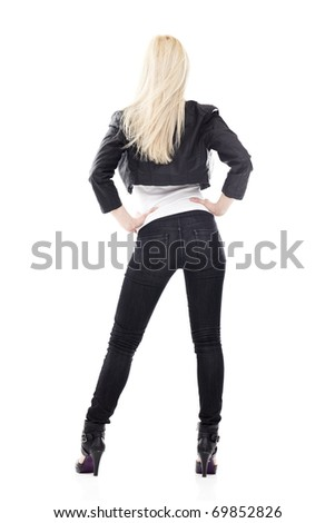 Back of young sexy blond woman in black jeans isolated on white - stock photo