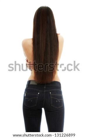 Back of young woman with long hairs dressed in jeans