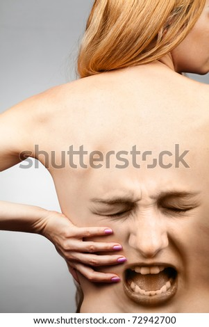 Back Pain Woman Suffering from Spine Injury - stock photo