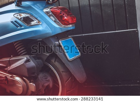 Back part of blue scooter. - stock photo