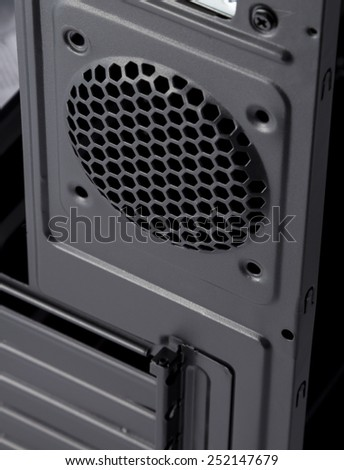 Back part of the computer casing. A place for fixing of the fan of cooling in the computer casing. Black computer casing.  - stock photo