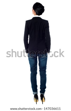 Back pose of a woman in business casuals - stock photo