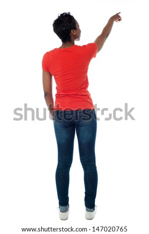 Back pose of a woman pointing at something