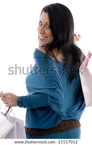 back pose of smiling model with carry bags on an isolated white background - stock photo