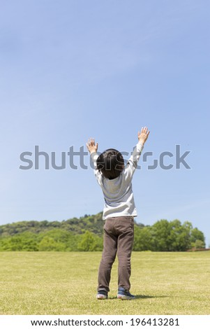 Back shot of blue sky Tewoageru children - stock photo