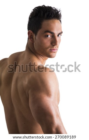 Back shot of shirtless muscular young man, relaxed pose, turning around to look at camera, isolated on white