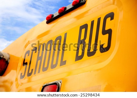 Back side of a yellow school bus - stock photo