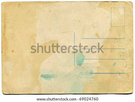 back side of an antique post card isolated on white