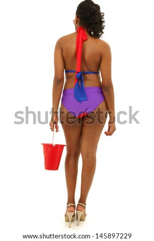 Back side of beautiful black woman in colorful swimsuit. - stock photo