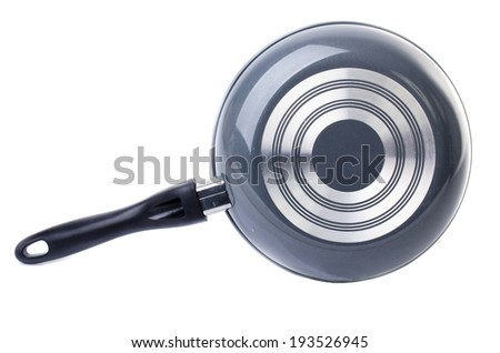 back side of black frying pan isolated on white background - stock photo