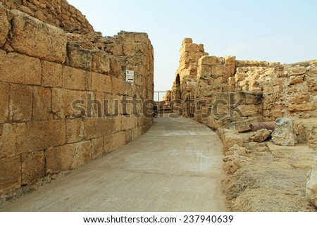 Back side of the Amphitheater ruins in Caesarea Maritima National Park, a city and harbor built by Herod the Great about 25-13 BC. The archaeological ruins are on the Mediterranean coast of Israel. - stock photo