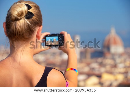 Back side of woman photographing majestic cityscape, Europe, Florence, Italy, Tuscany, travel and tourism concept - stock photo