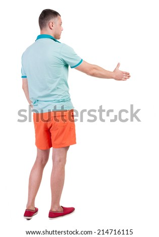 Back side view of man  in shorts handshake.   Isolated over white background.  - stock photo