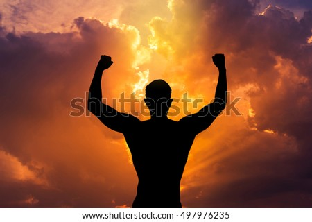 Back strong man outstretched arms posing fitness body on sunset background.