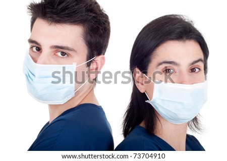 back to back portrait of a team of doctors wearing mask and uniform isolated on white background - stock photo