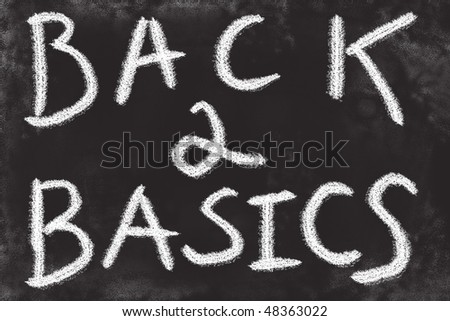 Back to basics chalkboard sign. Simple hand drawn message. - stock photo