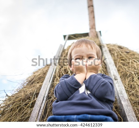 Back to nature enjoy, kid on hay
