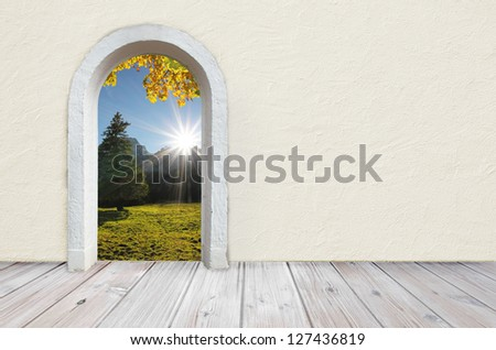back to nature, room with wooden rustic floor and beige colored wall with plastering, open gate with view to beautiful landscape - stock photo