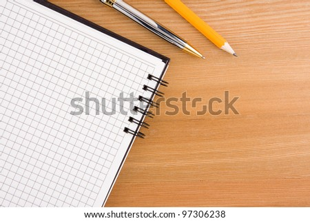 back to school and supplies on wood background - stock photo