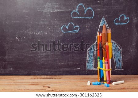 Back to school background with rocket made from pencils  - stock photo