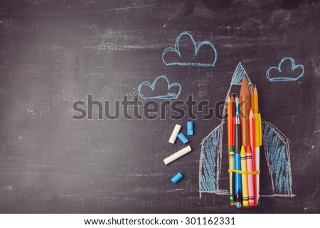 Back to school background with rocket made from pencils. View from above - stock photo