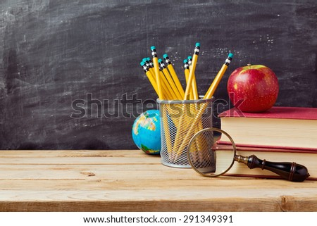 Back to school background with teachers objects over chalkboard - stock photo