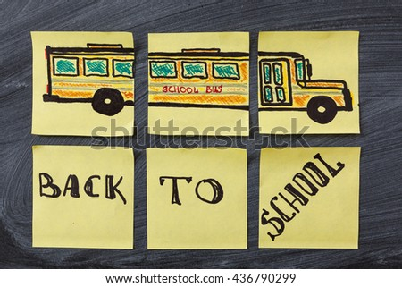 "Back to school background with title ""Back to school"" and ""school bus""  written on the yellow pieces of paper on the black school chalkboard - stock photo"