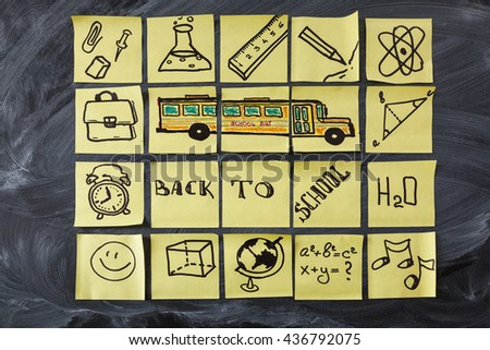 "Back to school background with title ""Back to school"", school bus and school attributes written on the yellow pieces of paper on the black school chalkboard - stock photo"