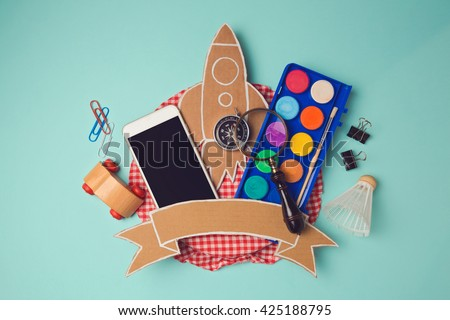 Back to school badge design with smartphone and cardboard rocket. Creative design hero header image. View from above. Flat lay - stock photo