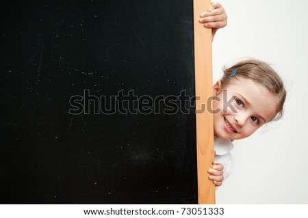 Back to school - blackboard and little schoolgirl - space for text - stock photo