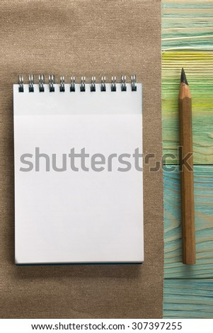 Back to school. Blank note pad, notebook with pen and glasses on wooden background. Copy Space. Education background