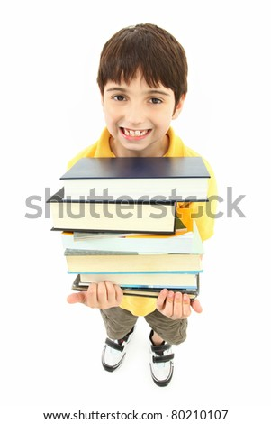 Back to school boy child with stack of text books and big smile.